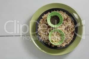 Muesli and cereal in plate on white background