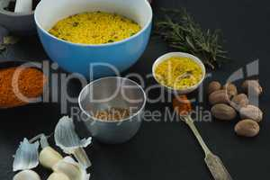 Rice in bowl with various spices ingredients
