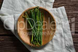 Fresh garlic chives in plate