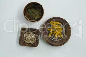 Turmeric raw seed, bay leaf and seed in bowl