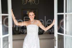 Beautiful bride standing at doorway