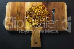 Mix spices with spoon wooden board