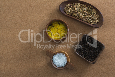 Coriander seeds, rice, black pepper seed and salt in bowl