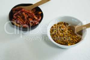 Dried red chili pepper and crushed red pepper in bowl