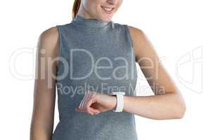 Mid section of businesswoman looking at wrist watch