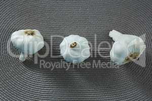 Garlics on placemat