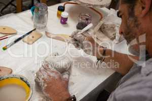 Attentive man molding sculpture