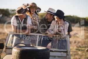 Happy friends enjoying during safari vacation