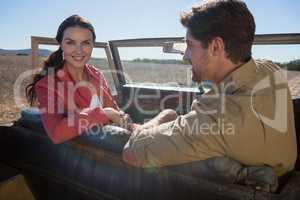 Portrait of woman with man in off road vehicle