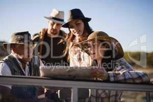 Friends reading map during safari vacation