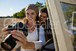 Couple looking at camera in off road vehicle