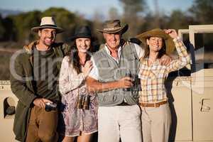 Portrait of happy friends enjoying during safari vacation