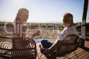 Senior couple having coffee while sitting at the resort