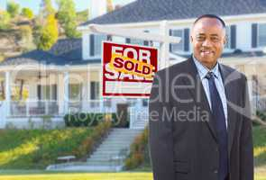 African American Agent In Front of Beautiful Custom House and So