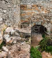 The medieval ruins of the fortress. The passage in the form of a