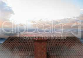 Roof with chimney and colorful sky