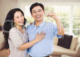 Couple Holding key in sitting room