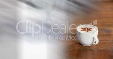 White coffee cup with star in foam and blurry white transition