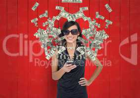 texting money. woman with rich appearance with phone. Money coming up from phone