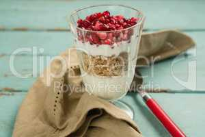 Cup of yogurt with raspberry and pomegranate