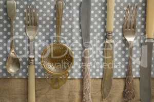 Directly above shot of cutlery arranged side by side