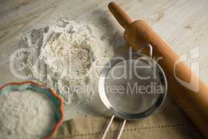 Close up of flour with rolling pin and strainer