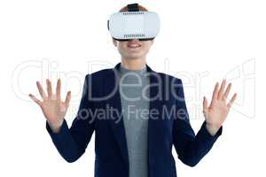 Happy businesswoman gesturing while wearing vr glasses