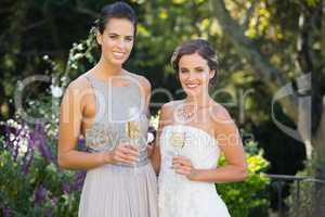 Portrait of bride and bridesmaid in wedding ceremony