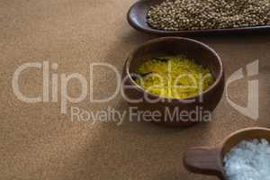 Coriander seeds, rice, and salt in bowl