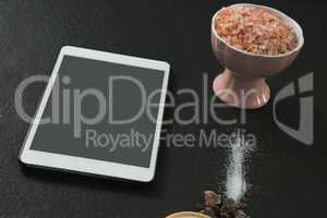 Salt in bowl with digital tablet