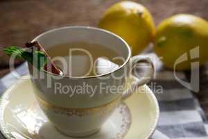 Cup of tea with lemon and cinnamon stick