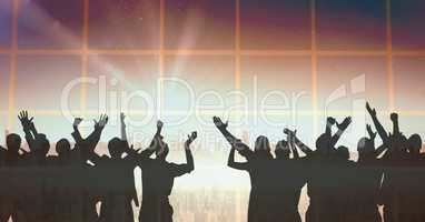 Silhouette of group of people celebrating at party with transition background and shining light
