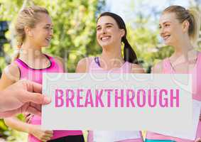 Breakthrough Text and Hand holding card with pink breast cancer awareness women