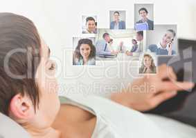 Man holding tablet with Profile portraits of people contacts