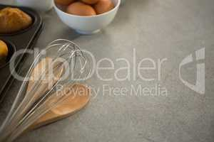 Wire whisk by egg and muffin tin