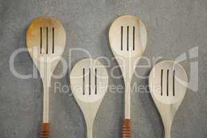 Directly above shot of spatulas arranged side by side