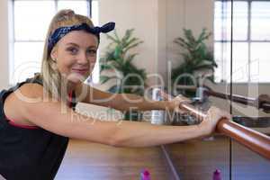 Portrait of beautiful dancer holding barre