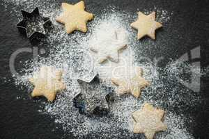 Overhead view of star shape cookies with pastry cutter