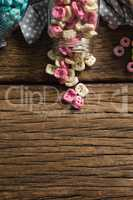 Scattered cereals from jar on wooden table