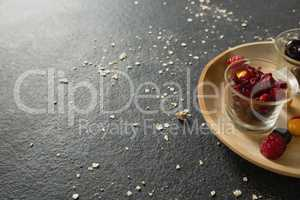 Fruits and dried fruits in wooden plate