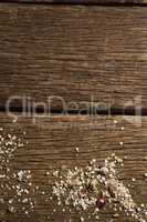 Scattered dry fruits and breakfast cereals on wooden table