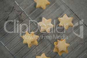 Close up of star shape cookies on cooling rack