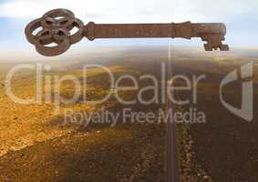 3D Rustic Key floating over barren landscape
