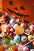 View of various sweet food by orange box