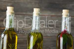 Olive oil bottles with herbal and spices