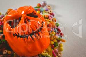 Close up of monster mask with various candies