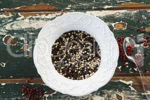 Mix peppercorns on wooden table