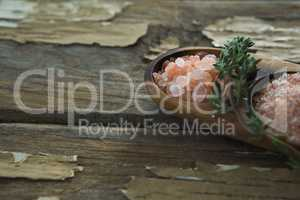 Himalayan salt with rosemary in wooden bowl