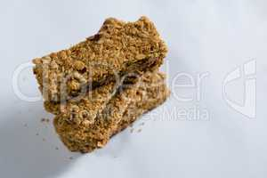 Stack of granola bar on white background