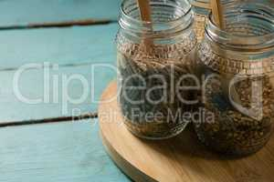 Jar with various breakfast cereals